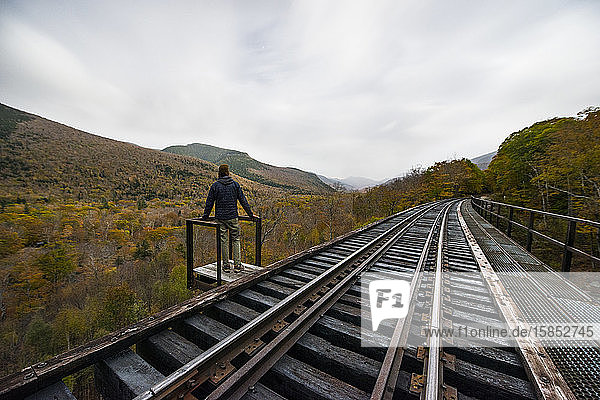 Abandoned Railroad Trestle high above New england autumn forest
