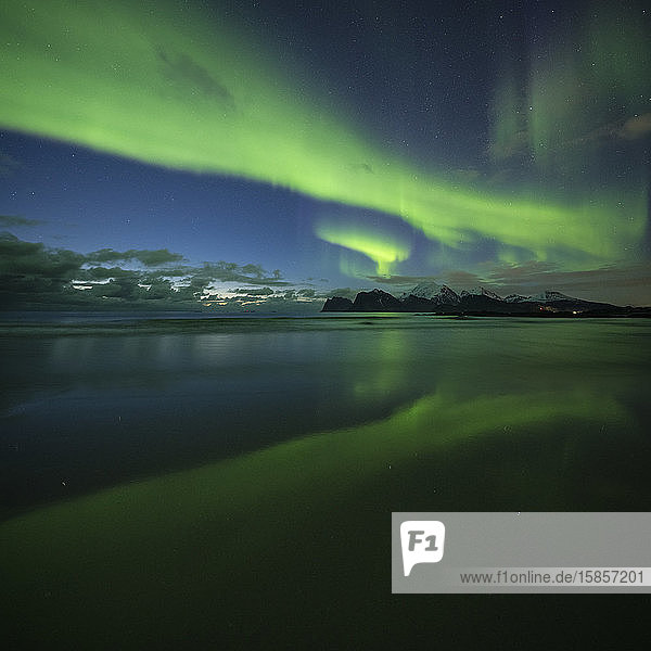 Reflection of Northern Lights - Aurora Borealis on Storsandnes beach  Flakstadøy  Lofoten Islands  Norway