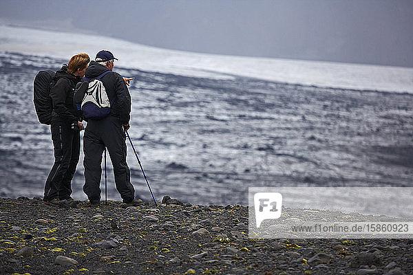 woman pointing towards glacier on Laugavegur trek