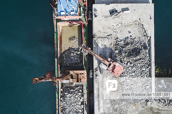 Mining machinery working on cargo ship