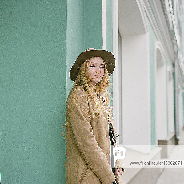 Beautiful blonde woman with a hat looking into camera and smile