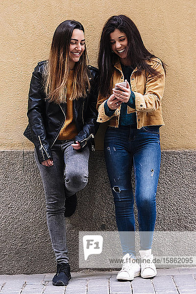 Beautiful women using a mobile at the Street. LGTB concept