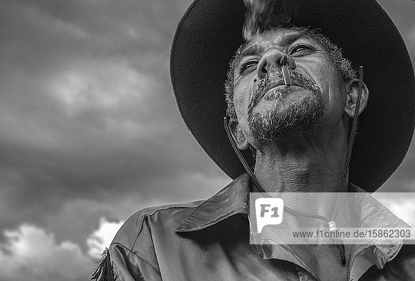 Portrait of Brazilian cowboy smoking handmade cigarette