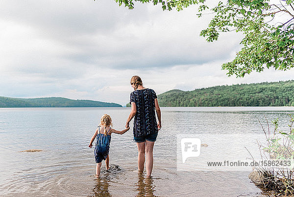 A mother and her daughter during a trip to the lake.