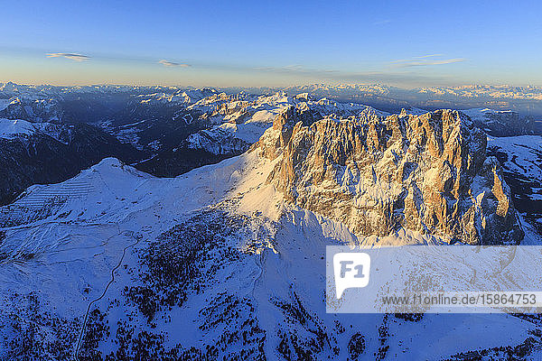 Aerial view of Sassolungo Sassopiatto and Grohmann peaks at sunset  Sella Group  Dolomites  Trentino-Alto Adige  Italy  Europe
