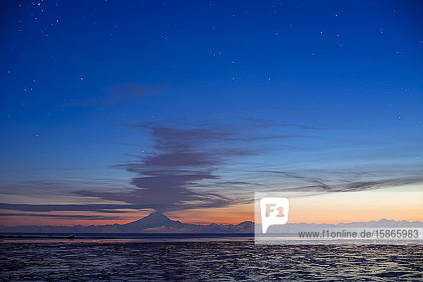 Ash Cloud Rises From Mt. Redoubt At Sunset During Low Tide Near Ninilchik  Alaska