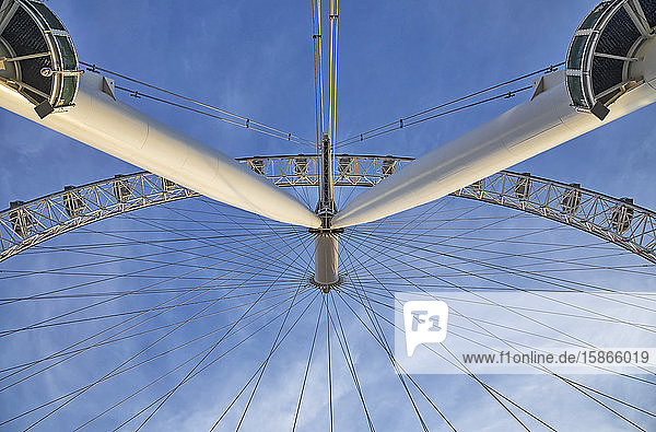 View from directly below the cables and pods of the London Eye with a blue sky in the background; London  England