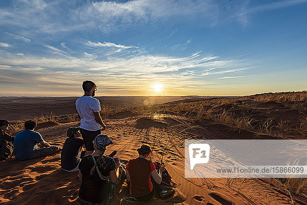 Tourists look out at the desert from Elim dune  Sesriem  Namib Desert; Namibia