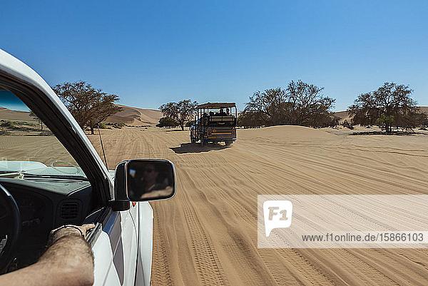 Tourists in a vehicle at Sossusvlei  Namib Desert; Namibia