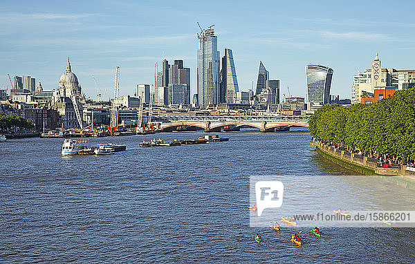 Boats on the River Thames with skyscrapers and landmarks; London  England