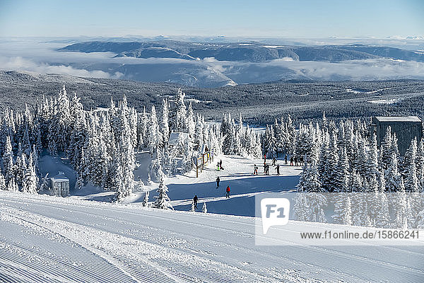 Skiiers outside a building at Sun Peaks Resort in the Rocky Mountains; Sun Peaks  British Columbia  Canada