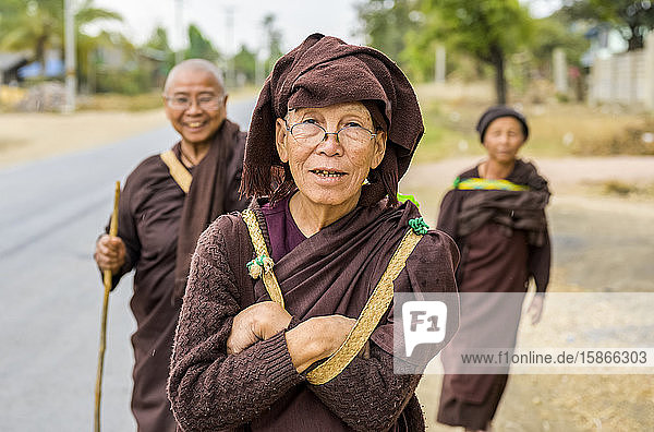 Buddhist Nuns standing on a roadside; Taungyii  Shan State  Myanmar