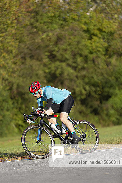 Cyclist riding on a road  near Trace Nachez Bridge; Franklin  Tennessee  United States of America
