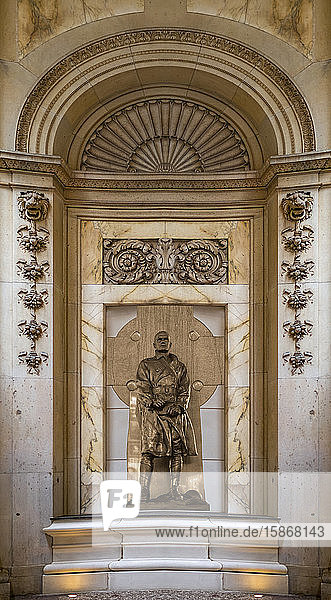 Sculpture of a male figure in a gold and marble niche; New York City  New York  United States of America