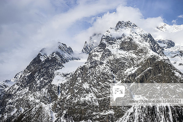 Rugged peaks of snow-covered mountains  Italian side of Mont Blanc; Courmayeur  Valle D'Aosta  Italy