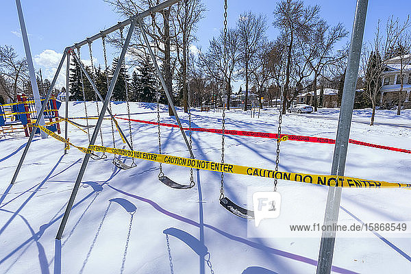 A playground cordoned off with caution tape during the COVID-19 World Pandemic; Edmonton  Alberta  Canada