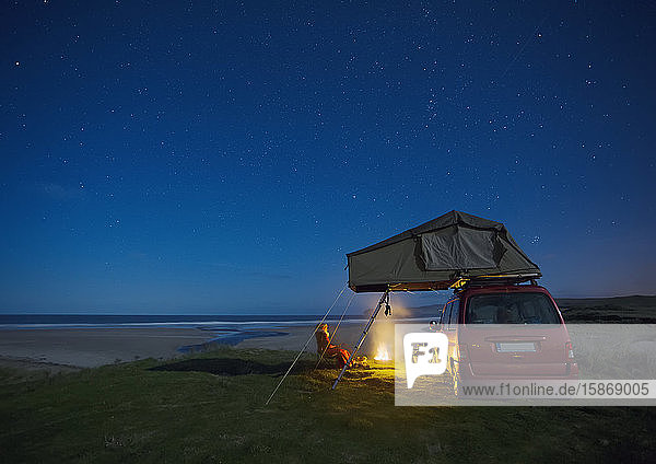 Car with roof tent camping by Falcarragh Beach at night; County Donegal  Ireland