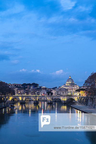 River Tiber with Umberto I Bridge and St. Peter's Basilica (Basilica di San Pietro) in background at dusk  Rome  Lazio  Italy  Europe