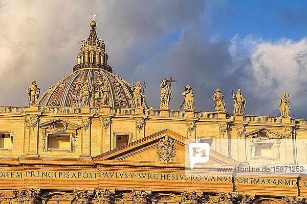 Sunrise over dome and religious holy statues of St. Peter's Basilica (Basilica di San Pietro)  Vatican City  UNESCO World Heritage Site  Rome  Lazio  Italy  Europe