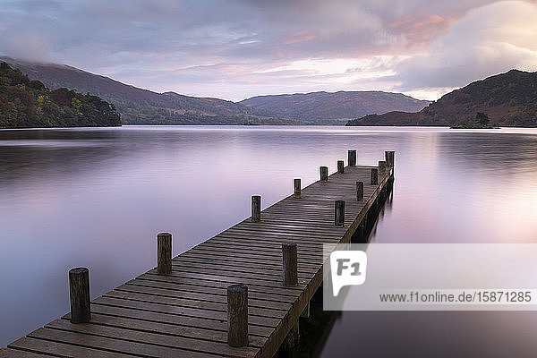 Wooden jetty on the shores of Ullswater at sunrise  Lake District National Park  UNESCO World Heritage Site  Cumbria  England  United Kingdom  Europe