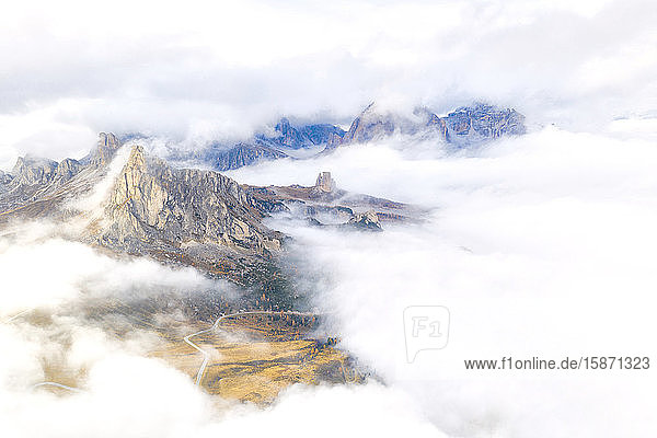 Aerial view by drone of Ra Gusela and Cinque Torri mountains covered by clouds and fog in autumn  Giau Pass  Dolomites  Belluno  Veneto  Italy  Europe