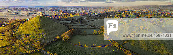 Aerial view by drone of Glastonbury Tor on a frosty morning on the Somerset Levels  Somerset  England  United Kingdom  Europe