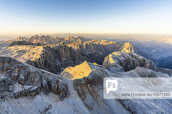 Aerial view of sunset over Sella Group and Odle mountain range in autumn  Val Gardena  Val Funes  Dolomites  South Tyrol  Italy  Europe