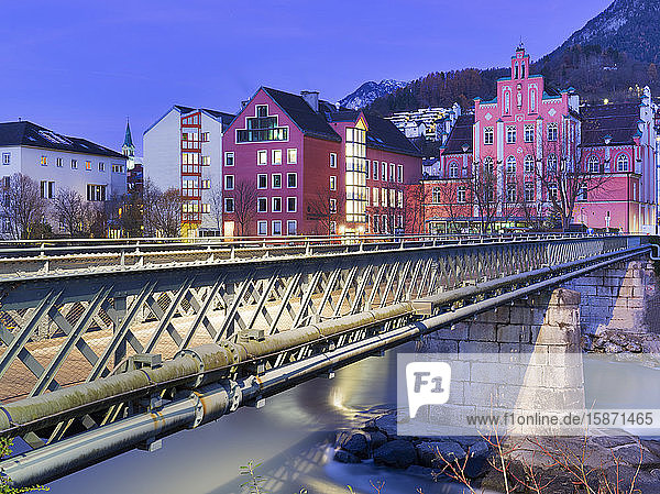 Pedestrian bridge cross the Inn river during twilight  Innsbruck  Tyrol  Austria  Europe