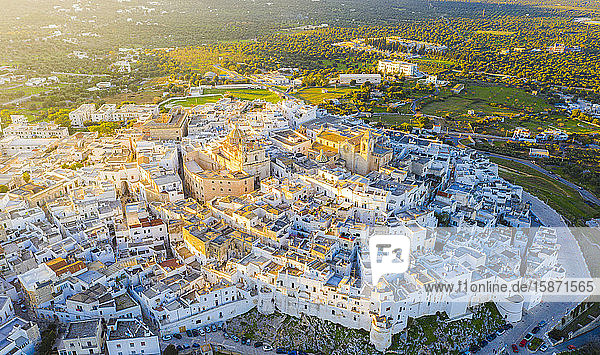 Aerial view by drone of the old town of Ostuni at sunset  Apulia  Italy  Europe