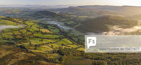 Aerial view by drone of mist floating over the Usk Valley at dawn  Brecon Beacons National Park  Powys  Wales  United Kingdom  Europe