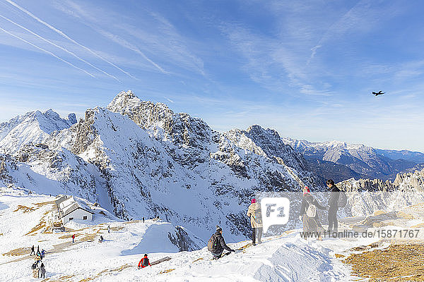 Tourists descends from Hafelekar peak  the top of ski resorts of Innsbruck  Tyrol  Austria  Europe