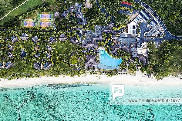 Aerial view by drone of luxury tourist resort on palm-fringed beach facing the tropical lagoon  Le Morne Brabant  Mauritius  Indian Ocean  Africa