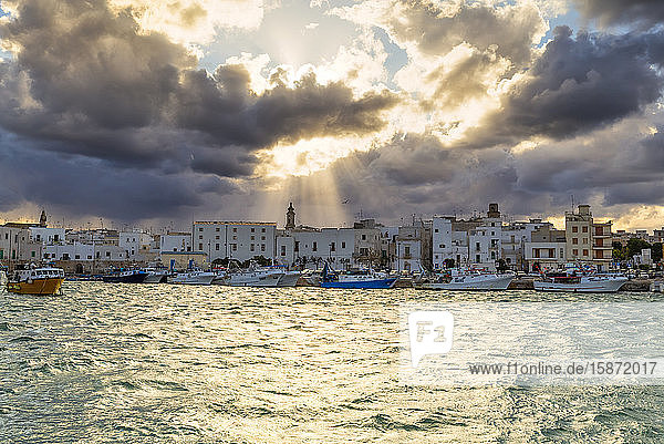 Old town illuminated by sun rays that filters between clouds  Monopoli  Apulia  Italy  Europe