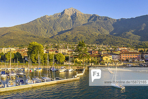 Sailing boat arrived at the port of Colico village  Lake Como  Lombardy  Italian Lakes  Italy  Europe