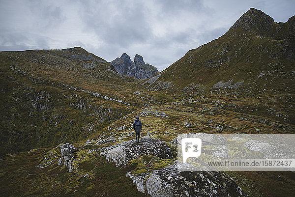 Man standing on mountain in Lofoten Islands  Norway