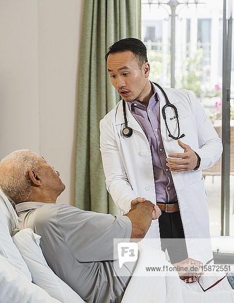 Senior man and doctor shaking hands Senior man and doctor shaking hands