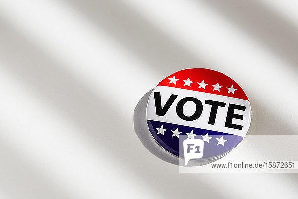 Vote button on white background