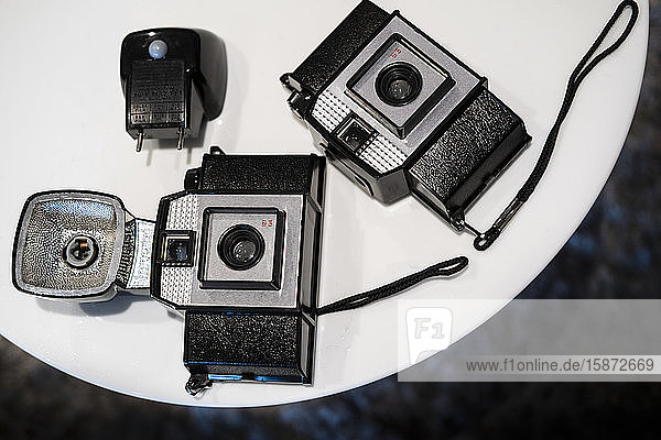 Antique cameras on table