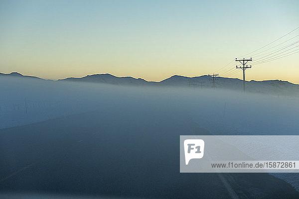 Road in fog at sunrise Road in fog at sunrise