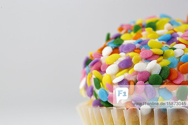 Cupcake with colorful sprinkles