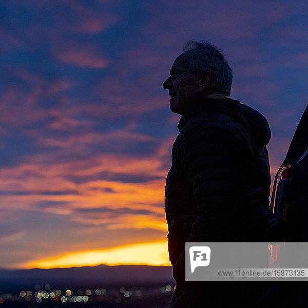 Silhouette of senior man at sunset
