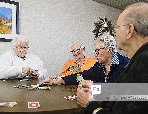 Senior people playing card game