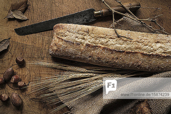 Bread  knife  wheat  acorns  branches  leaves and fabric Bread, knife, wheat, acorns, branches, leaves and fabric
