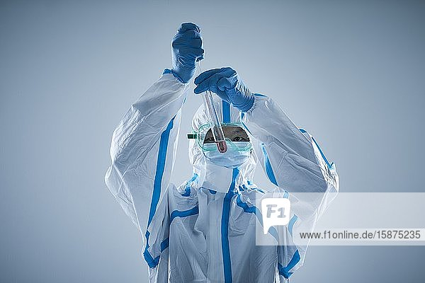 Japanese man wearing protective suit for disease prevention
