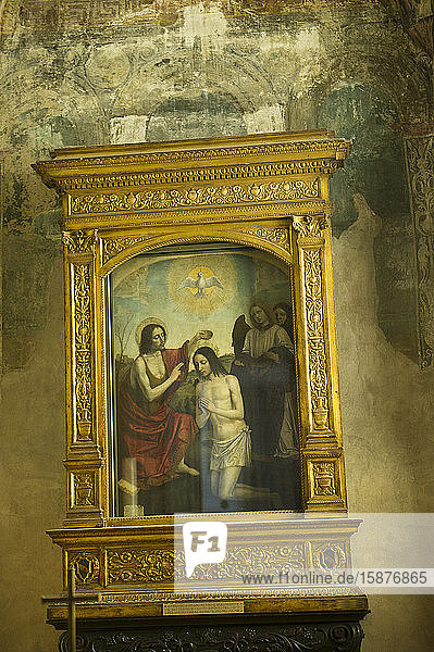 Italy  Lombardy  Melegnano - Minor Basilica of San Giovanni Battista. In the chapel of the baptistery is the painting depicting the Baptism of Christ  by Ambrogio da Fossano known as il Bergognone
