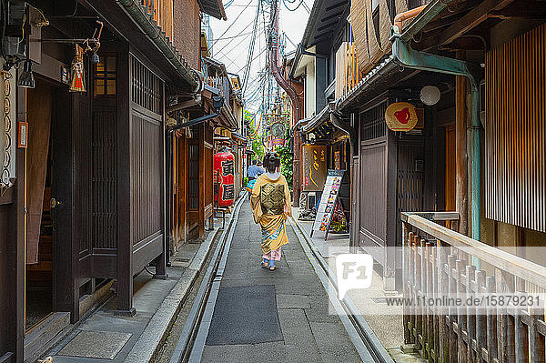Kyoto  Japan  A lady in traditional kimono walking in a alley of the ancient Ponto-Cho district