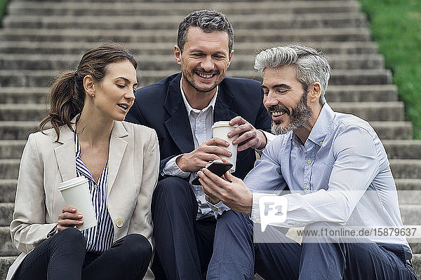 Businesspeople relaxing in public park