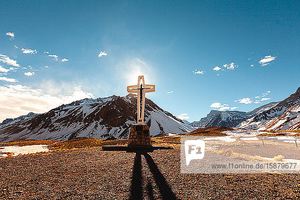 View of cross with mountains