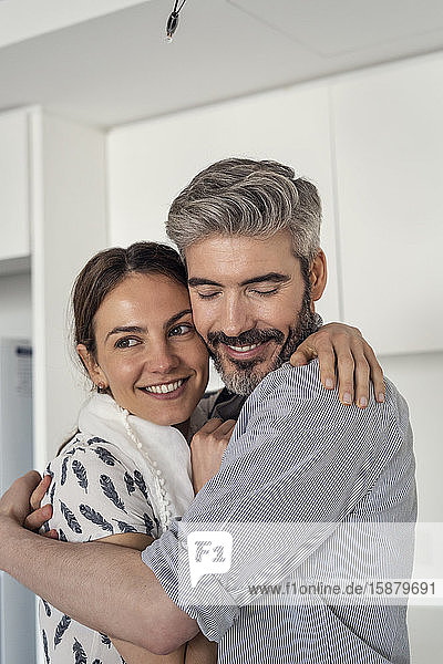 Smiling couple embracing each other