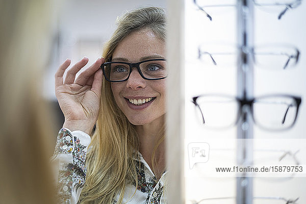 Young woman wearing eyeglasses in store